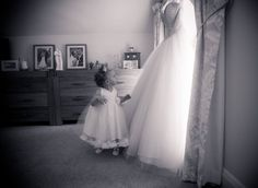 My daughter looking up at my wedding dress