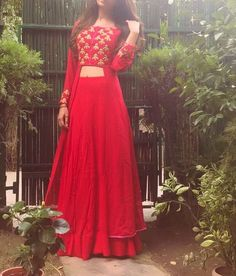 Beautiful red lehnga skirt and long jacket style blouse with golden embroidery | Light lehengas | Mehndi outfit inspiration | Sister of the bride outfit ideas | Indian bridesmaids | Image source: Pinterest | Every Indian bride's Fav. Wedding E-magazine to read. Here for any marriage advice you need | www.wittyvows.com shares things no one tells brides, covers real weddings, ideas, inspirations, design trends and the right vendors, candid photographers etc.