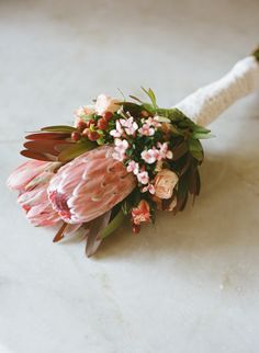 Beautiful pink bouquet with king protea blooms by Persnickety Events, image by To Love Photographie. #wedding #bridal