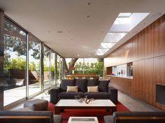 The interior is cozy and luminous with the wall-to-ceiling windows.