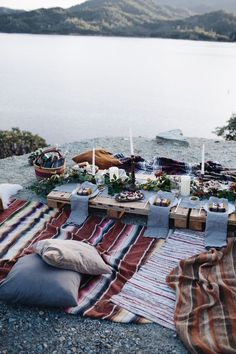 Holiday Entertaining Tips and Ideas : A Holiday Feast By The Lake. Host a chic and cozy winter picnic by the lake with tons of blankets and pillows
