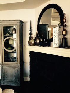 Furniture and mantel decor by Nelson Designs. Mix of metal tones and white woodwork with black accents. Nelson Designs is a family owned interior design firm in Wichita, KS.