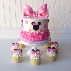 Minnie Mouse cake and cupcakes                                                                                                                                                                                 More