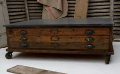 Plan chest coffee table with zinc top. Somewhere to store some favorite prints