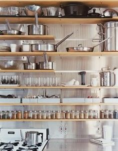 Exposed shelving, making kitchen tools work overtime as both functional & a delicious aesthetic.
