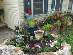 New rock wall and stacked flower pot garden