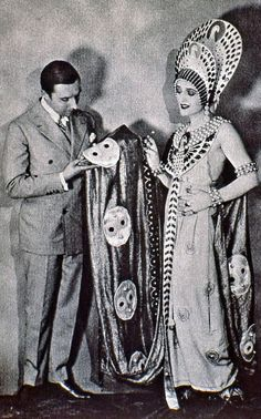 Carmel Myers in her Ben-Hur costume with Erté (aka Romain de Tirtoff), the designer of the costume. 1925.