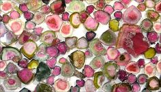 watermelon tourmaline slices  Photo is copyright free for non-commercial educational uses.  Just credit photo to R.Weller/Cochise College.    Gemstones courtesy of Vista Gems  Specializing in precious and semiprecious stones  Jay Khan  P.O. Box 184, Skillman, NJ 08558  (800)-218-5139