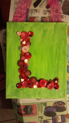 Painted canvas with buttons letter