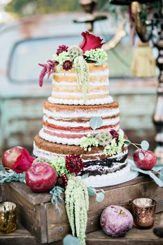 naked wedding cake topped by flowers