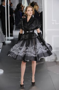 Christian Dior - He's got the ruffles and pleates down.
