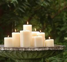 candles in the bird bath