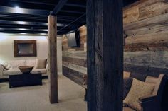 Looking to cover up your basement poles? We put together a gallery of the 50 Best Basement Pole Ideas. Check out these basement pole ideas! Rustic Basement, Modern Basement, Basement Walls, Basement Black Ceiling, Small Basement Remodel, Basement Renovations, Basement Pole Covers, Basement Makeover, Refinished Basement Ideas