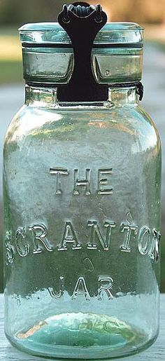 THE SCRANTON JAR in apple green color with odd closure that has wooden components.