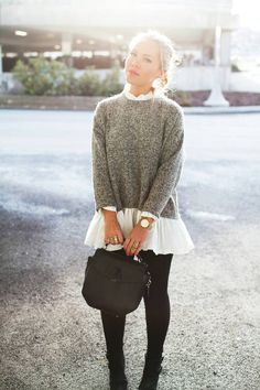 A flirty look for work - Black Tights, Booties, Loose grey sweater and a flowy white skirt