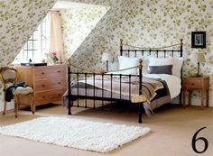 Canterbury brass and iron bedframe from Feather & Black and bold patterned wallpaper from Little Greene