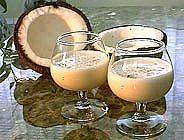Recipe Coquito PuertIngredients:   1 taza de leche de coco o 1/2 taza de crema de coco  4 yemas de huevo  1 cdta.de vainilla  1 lata de leche evaporada  1 lata de leche condensada  1 1/2 taza de ron blanco o Rico