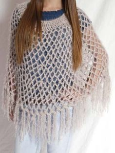 Ponchos..had one like this.  My mother made me a lot of these ponchos, Rebecca Littlefield