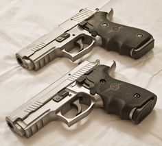 SIG Duo - The top one is the SIG P220 Carry Stainless Elite, the bottom one is the SIG P229 Stainless Elite.