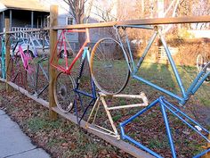 In Ithaca, NY, here's an interesting fence made out of old bicycle parts. It encloses a place that takes old bikes and fixes them up.