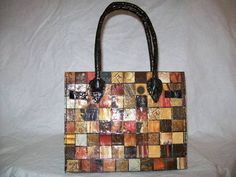 Magazine and Duct Tape Purse, this looks awesome.  Read the How to and it was amazing.  Must make one of these, maybe 2.