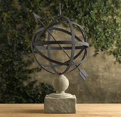 LOVE this Armillary, such simple clean lines...sitting on cement stand!