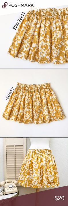 """Forever 21 Sweet Summer Floral Print Cotton Skirt Forever 21. Wide elastic smocked waistband: 14 1/4"""" across, 2 1/4"""" wide. Length: 16 inches. Colors: mustard yellow and ivory. Labeled size medium. fully lined. Tucked gathers at waist, could be ironed down to create more of a pleat. Summertime favorite. Used item in very good condition!❤️ Forever 21 Skirts Mini"""