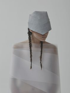 Inspired by the hair braids of the Carpathian gypsies, Budapest-based designer Agnes Kovacs created her line, called System and Form, which includes bags and a hat, all made from leather. The Carpathian people wear various styles of braids, from three, four, five, and even 22 branches, and only let their hair down on festive days. Typically Kovacs begins with a flat surface and with this collection, she formed the braids off the flat areas of the leather.