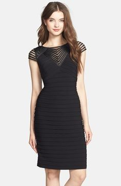 Love the detail on the neckline on this black cocktail dress!