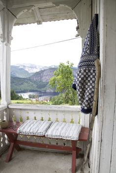 Everything about this  appeals to me. The cozy spot, the Norwegian sweater, the view, the woodwork.