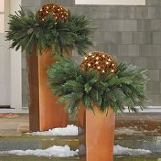 Column Planter We could spray paint wood, gold to make a planter and then make a less holiday looking arrangement with greens, branches and twinkle lights. Christmas Urns, Christmas Planters, Christmas Arrangements, Outdoor Christmas Decorations, Winter Christmas, Christmas Home, Flower Arrangements, Christmas Wreaths, Christmas Crafts