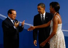 Michelle Obama and Barack Obama Photos Photos - (AFP OUT) U.S. President Barack Obama (C) and U.S. first lady Michelle Obama (R) welcome Italian Prime Minister Silvio Berlusconi to the welcoming dinner for G-20 leaders at the Phipps Conservatory on September 24, 2009 in Pittsburgh, Pennsylvania. Heads of state from the world's leading economic powers arrived today for the two-day G-20 summit held at the David L. Lawrence Convention Center aimed at promoting economic growth. - World Leaders…
