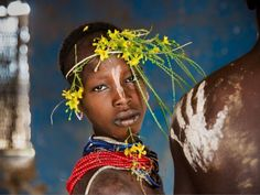 View Child adorned with flowers by Steve McCurry on artnet. Browse more artworks Steve McCurry from Artelandia. Steve Mccurry, Children Photography, Portrait Photography, Photography Tips, Street Photography, Landscape Photography, Nature Photography, Fashion Photography, Wedding Photography