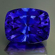 Tanzanite Cushion Radiant/Barion Style Cut  Weight: 6.54 cts  Measurements: 12x9.6mm, depth 7.6mm  Clarity: VVS  Origin: Tanzania  Enhancements: Heat only  Order/Stock No.: tanzanite_631  Description: This is the good stuff! Top color and huge size, awesome! Intense violet-blue, well cut and clean.   (Cut by Andrew Gulij)   Pantone 2738/2735C