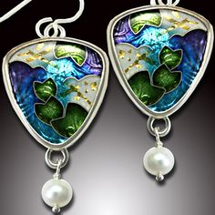 Not a huge fan of cloisonne, but I love love love this work by Ricky Frank!!  Very lucky to have a pair of earlier work earrings. From seeing the prices now, I better guard them with my life!!   :))