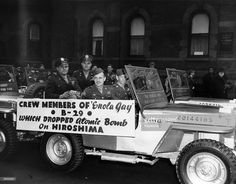 Crewmembers of the 'Enola Gay,' the American B-29 bomber which dropped the atomic bomb on Hiroshima, including (left to right) co-pilot Captain Robert A. Lewis, commander and pilot Paul W. Tibbets Jr., tailgunner Staff Sergeant George Caron, and flight engineer Staff Sergeant Wyatt Duzenbury, proudly parade through New York on a jeep in the first Army Day Parade since the end of the War, April 12, 1946.