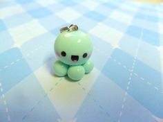 Adorable! And one of my favorite colors :)  Kawaii Charm Baby Octopus Mint Chibi Charm Cute by JollyCharms