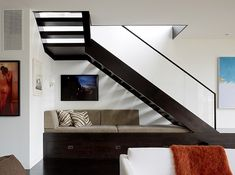 Guest sleeping/ seating and storage under stairs  ~~  Cow Hollow Residence by Dijeau Poage Construction
