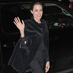 """Dress up an all-black outfit with """"extra special pieces in the hue to make things extra special"""" like Angeline Jolie in a Saint Laurent velvet cape #Style"""