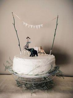 Birthday cake with toy animals.