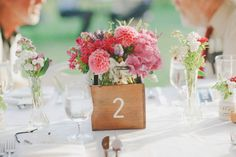 Wine box centerpieces doubling as table numbers. Photography by yvonne-wong.com, Wedding Planning by alisonlum.com, Floral Design by melaniebensonfloral.com