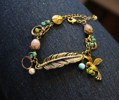 Check out this item in my Etsy shop https://www.etsy.com/listing/226093602/vintaj-feather-bracelet-nature-charm