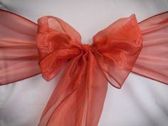 Chair Rentals- Burnt Orange Organza Chair Sash. Complete the look with a matching table runner or napkin. Check out our other fabrics at Eventrentalutah.com or follow our board on Pinterest