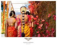 South Indian bride. Temple jewelry. Jhumkis Yellow and pink silk kanchipuram sari.Braid with fresh flowers. Tamil bride. Telugu bride. Kannada bride. Hindu bride. Malayalee bride.Kerala bride.South Indian wedding.