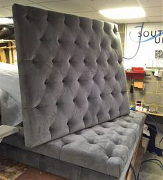 Upholstered headboard in grey velvet