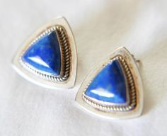 SoVintageous is offering these gorgeous vintage southwestern artisan handmade sterling silver post earrings with wonderful bezel-set blue denim lapis.  In excellent vintage condition, the earrings wer