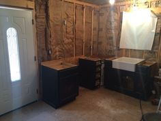 Kitchen cabinets in place in cabin kitchen