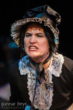 Mrs Sowerberry - I like the hat and lace collar