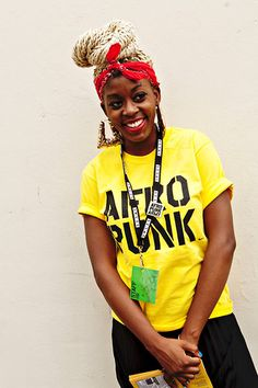 Bella Smith, a volunteer, paid tribute to early 1980s fashion in oversize door-knocker earrings accented with a red bandanna. (via Street Style: Afro-Punk Music Festival - Slide Show)