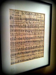 Tea stained sheet music to the bride and groom's first dance song.